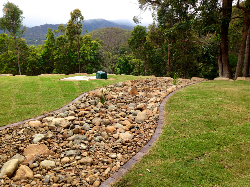 Channel drainage pits and irrigation for Landscape renovations